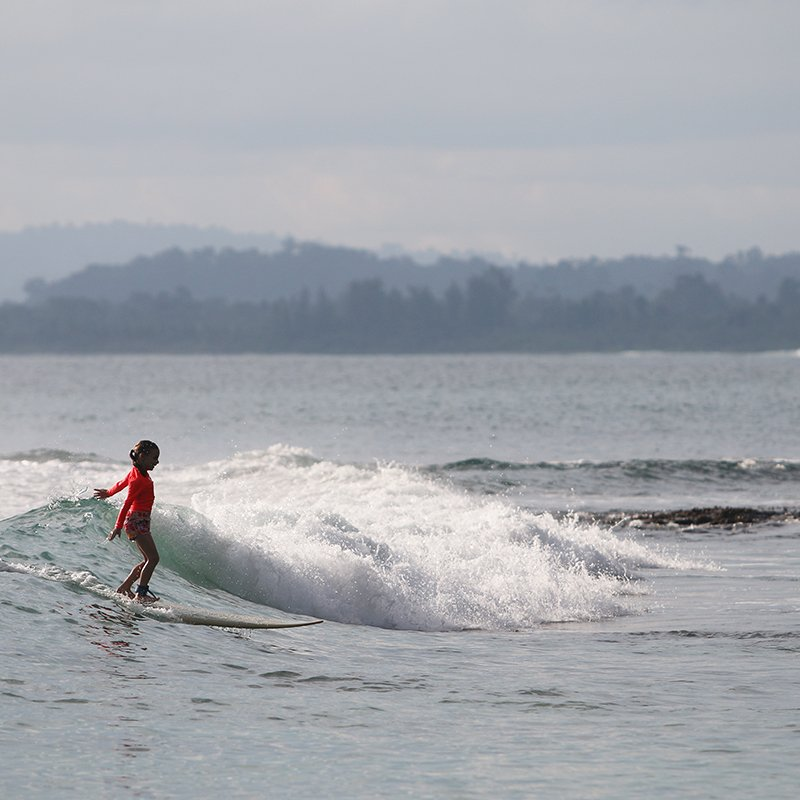beginner surfing waves in mentawai