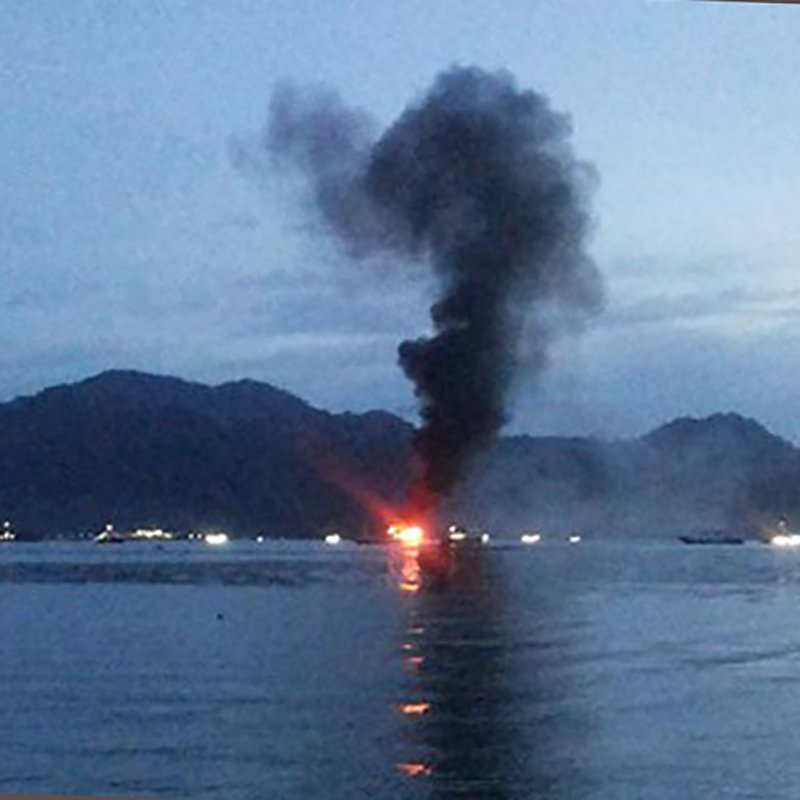 A tourist charter boat burns and sinks in Sumatra.